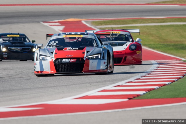 M1 GT Racing with Driver Walt Bowlin Head to Barber Motorsports Park for Their Second Pirelli World Challenge Event of the Season in front of a porsche