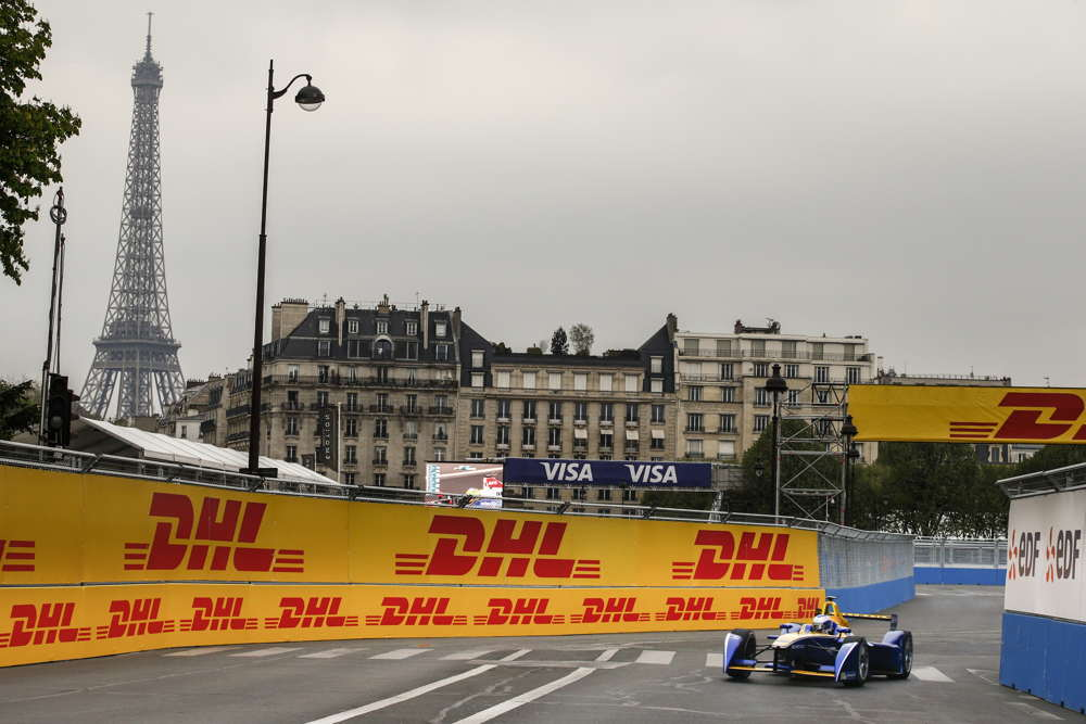 Prost racing in this historic venue with the eiffel tower in the backdrop