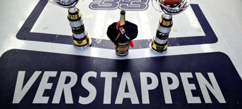Max Verstappen name with the trophies