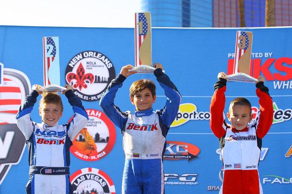 benik kart on the podium