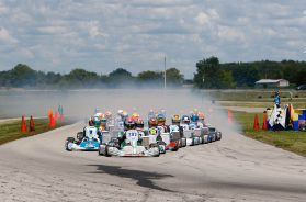 Jeremy Fairbairn leads the field of X30 Junior drivers into turn one at New Castle Motorsports Park