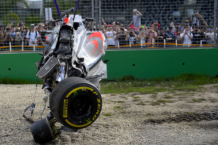 Alonso'S Formula being lifted after his big accident in the season opener 2016
