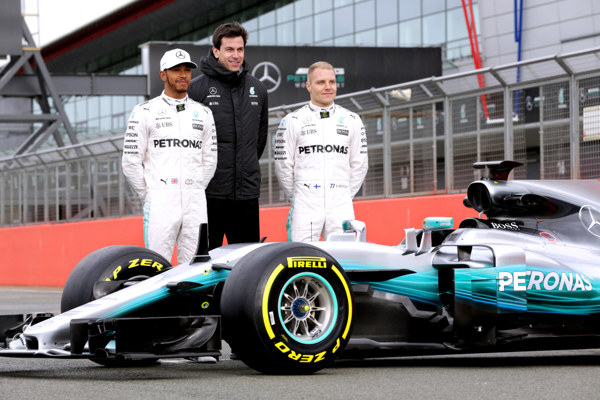 2017 drivers Hamilton and Bottas with team boss and New car