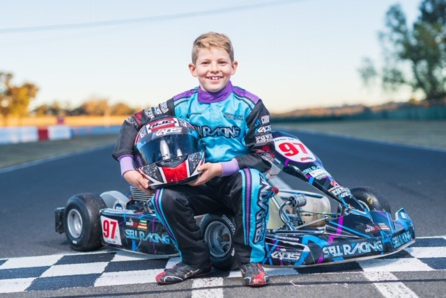 Karting Duo Wave The Flag for Autism Awareness Month